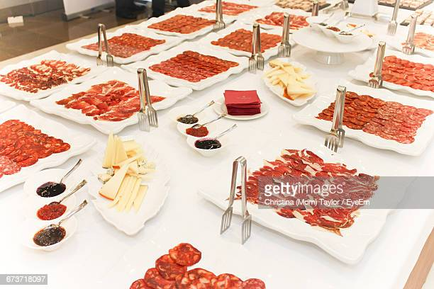 High Angle View Of Meat In Plates On Table