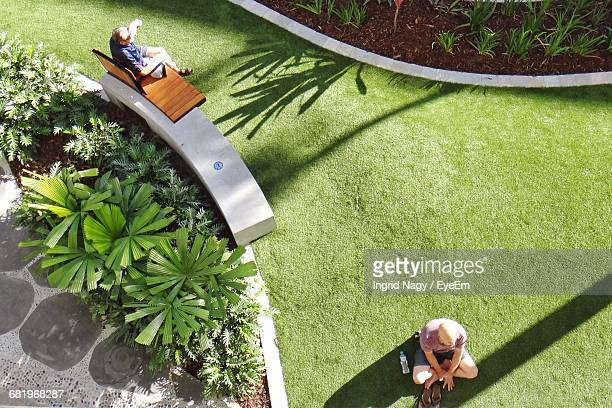High Angle View Of Men Relaxing In Park