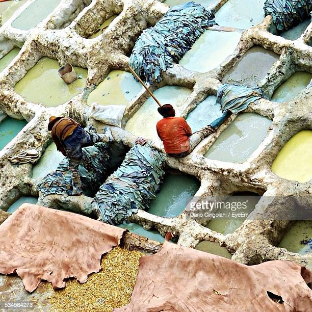 High Angle View Of Men Working At Dye Pits