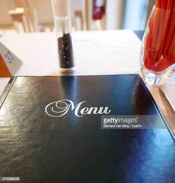 High Angle View Of Menu On Table In Restaurant