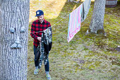 High angle view of mid adult man hanging out laundry in garden