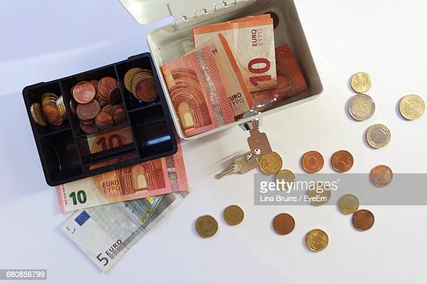 High Angle View Of Money With Containers On Table