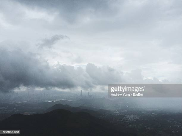 High Angle View Of Mountains Against Cloudy Sky On Foggy Day