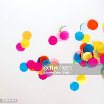High Angle View Of Multi Colored Confetti Against White Background