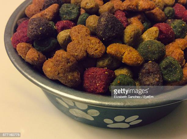 High Angle View Of Multi Colored Dog Food In Bowl On Floor