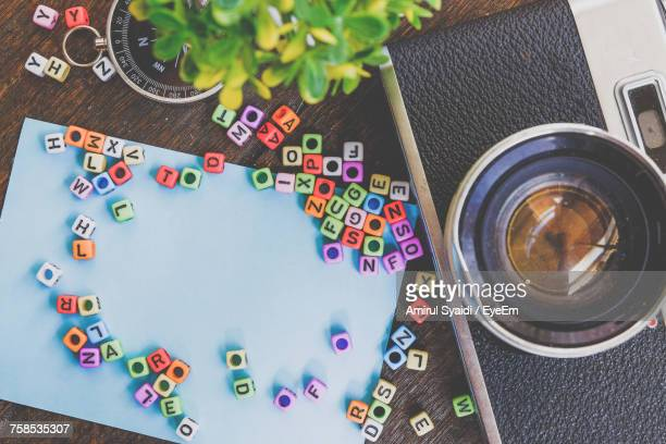 High Angle View Of Multi Colored Leters On Table