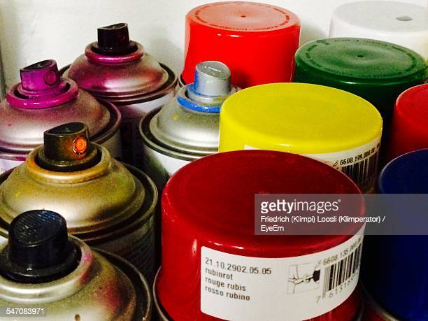 High Angle View Of Multi Colored Spray Paints