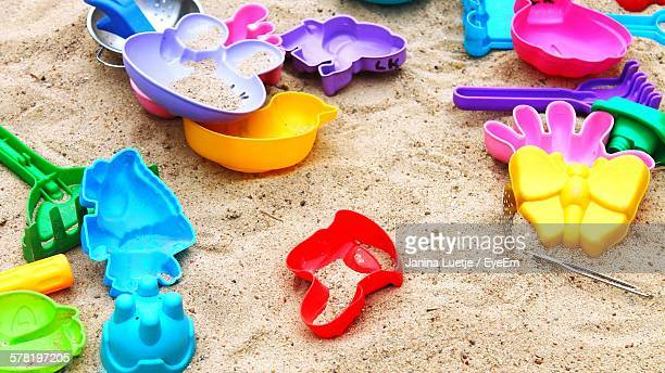High Angle View Of Multi Colored Toys On Sand