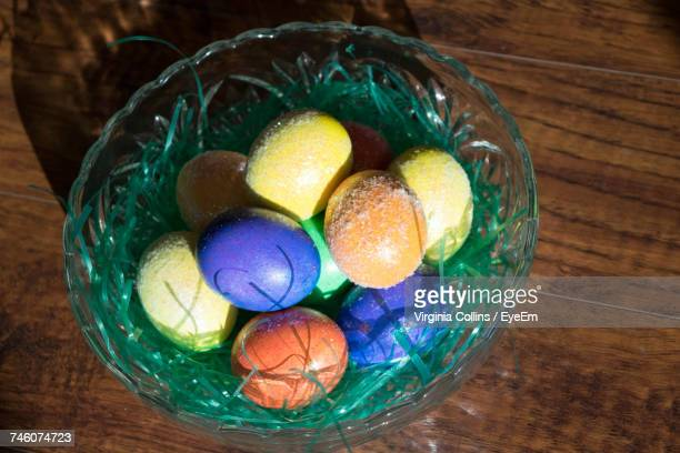 High Angle View Of Multicolor Easter Eggs In Bucket On Table