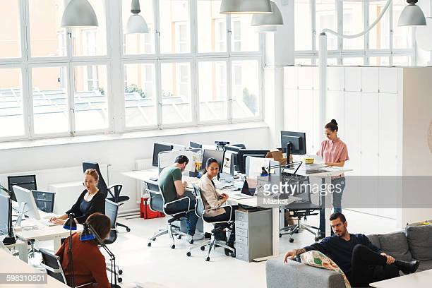 High angle view of multi-ethnic business people working in modern office