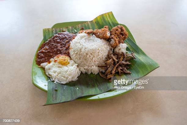 High Angle View Of Nasi Lemak Served On Banana Leaf In Plate