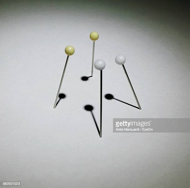High Angle View Of Needles On White Background