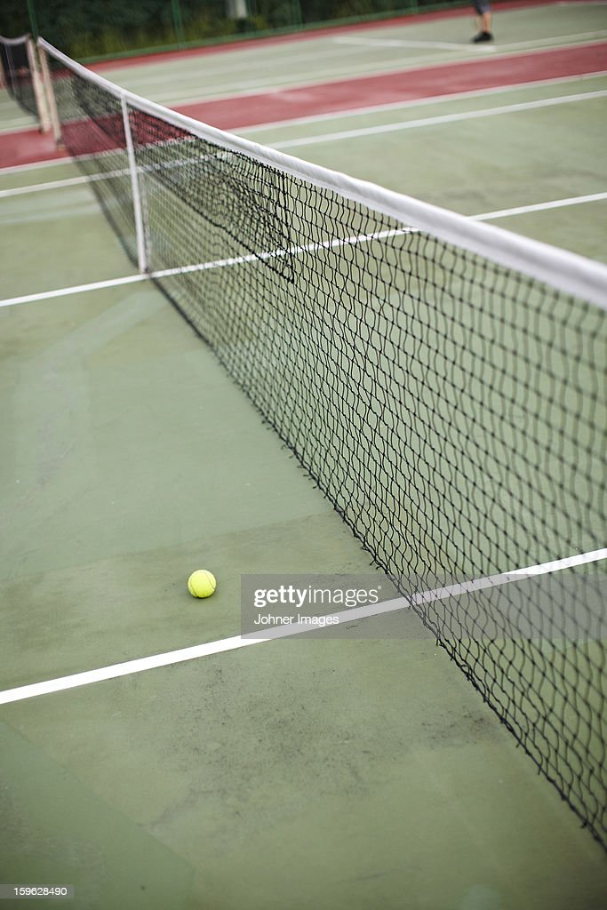 High angle view of net and tennis ball : Stock Photo