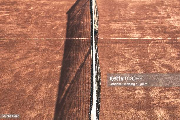 High Angle View Of Net At Tennis Court