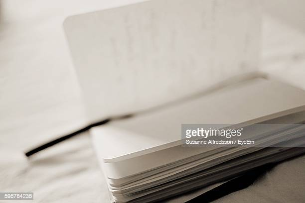 High Angle View Of Notebook On Table