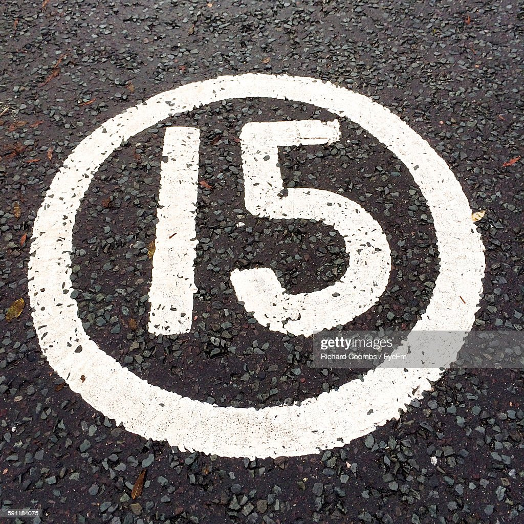 High Angle View Of Number Painted On Street