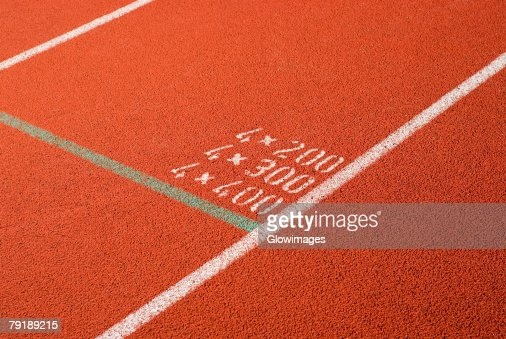 High angle view of numbers painted on a running track : Stock Photo