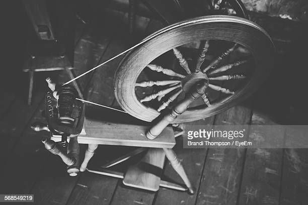High Angle View Of Old Spinning Wheel At Home