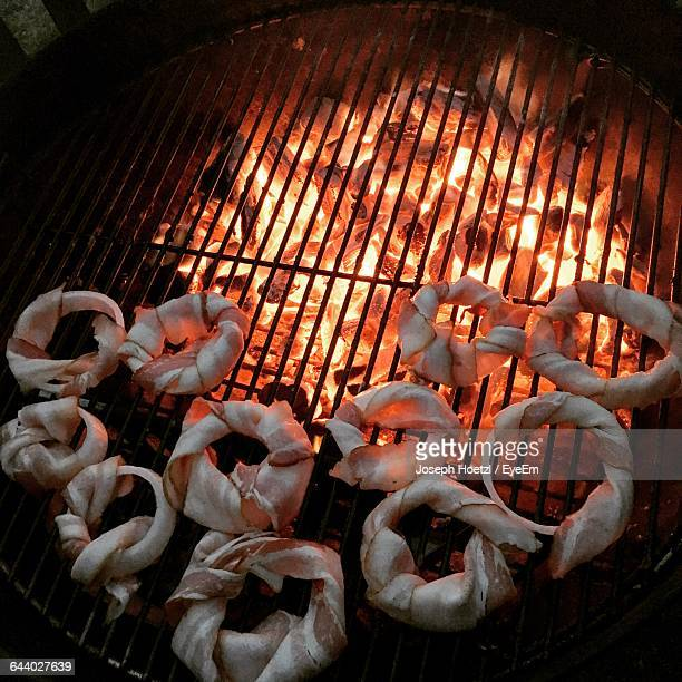 High Angle View Of Onion Ring On Barbecue Grill