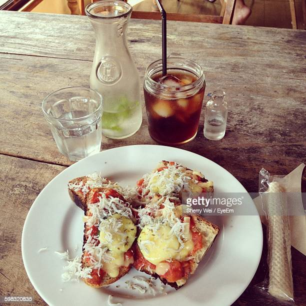 High Angle View Of Open Faced Sandwich And Drinks On Table