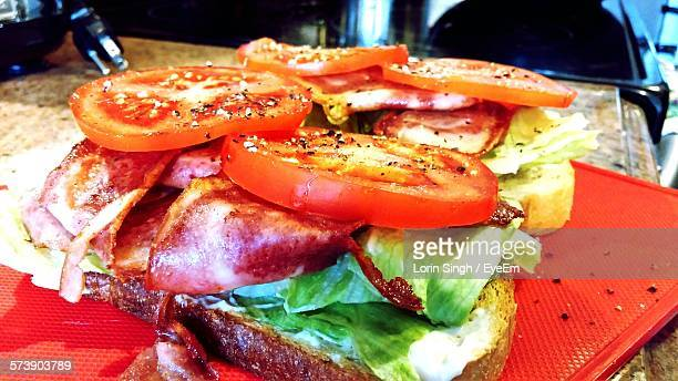High Angle View Of Open Faced Sandwiches Of Bacon On Table