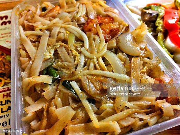 High Angle View Of Pad Thai In Container On Table