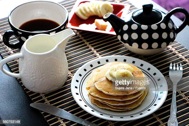 High Angle View Of Pancakes And Tea For Breakfast Served On Table