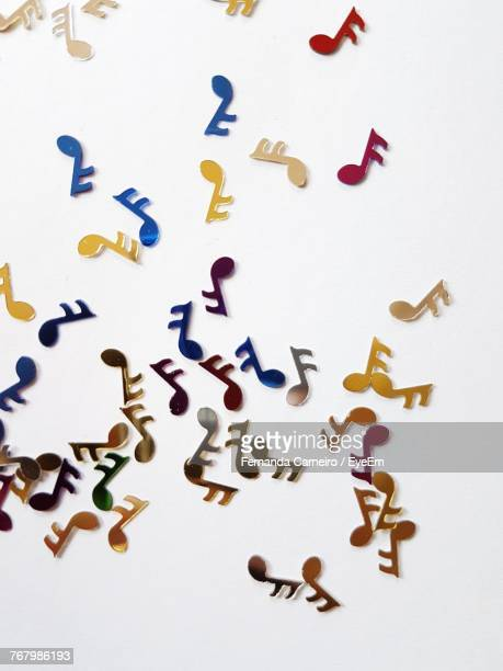 High Angle View Of Paper Music Icons Over White Background