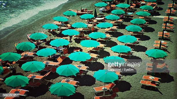 High Angle View Of Parasols And Lounge Chairs On Amalfi Beach