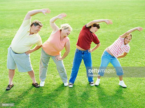 high angle view of parents and their children exercising in the park