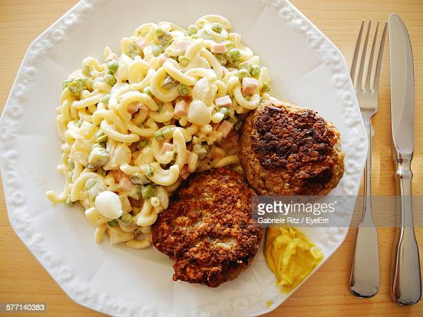 High Angle View Of Pasta With Cutlets On Plate
