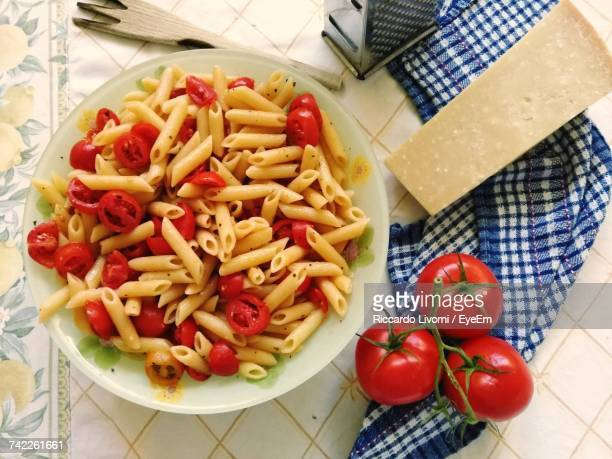 High Angle View Of Pasta With Tomato Slices In Bowl