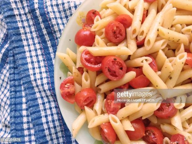 High Angle View Of Pasta With Tomatoes Served In Plate On Table