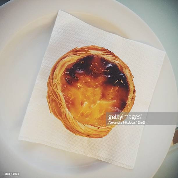 High Angle View Of Pastel De Nata In Plate On Table