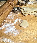 High Angle View Of Pastry Cutter And Dough On Table