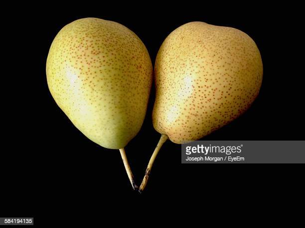 High Angle View Of Pears On Black Background
