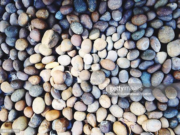 High Angle View Of Pebbles Stones On Beach