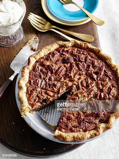 High angle view of pecan pie with slice missing