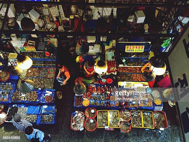 High Angle View Of People At Market Stall In City