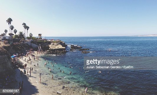 High Angle View of People Enjoying At Sea Shore Against Clear Sky