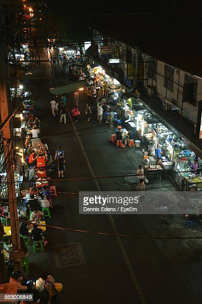 High Angle View Of People Having Dinner At Street Food Stalls