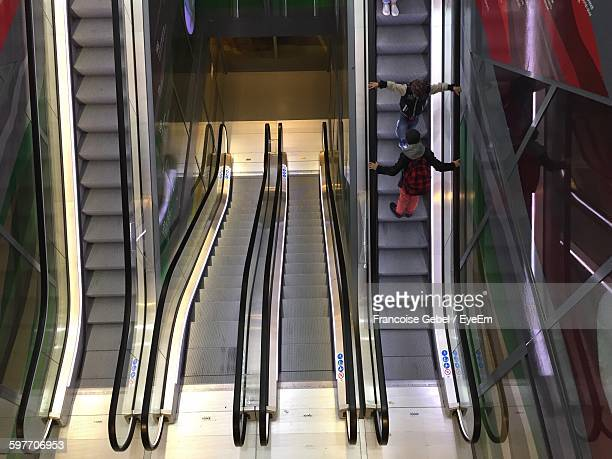 High Angle View Of People In Escalator
