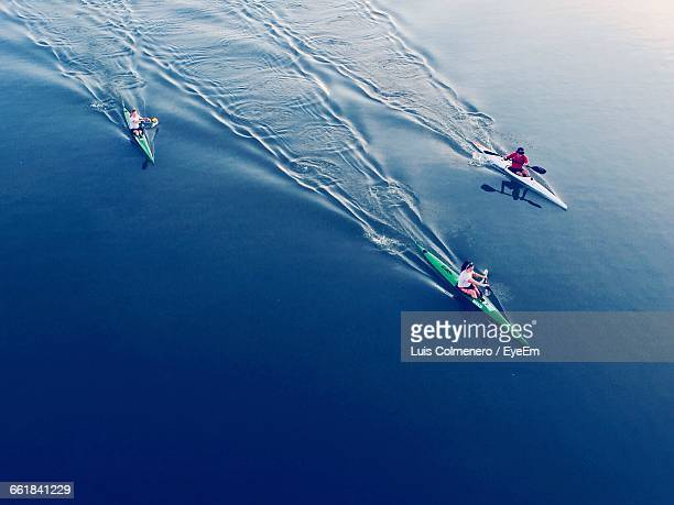 High Angle View Of People Kayaking In Sea