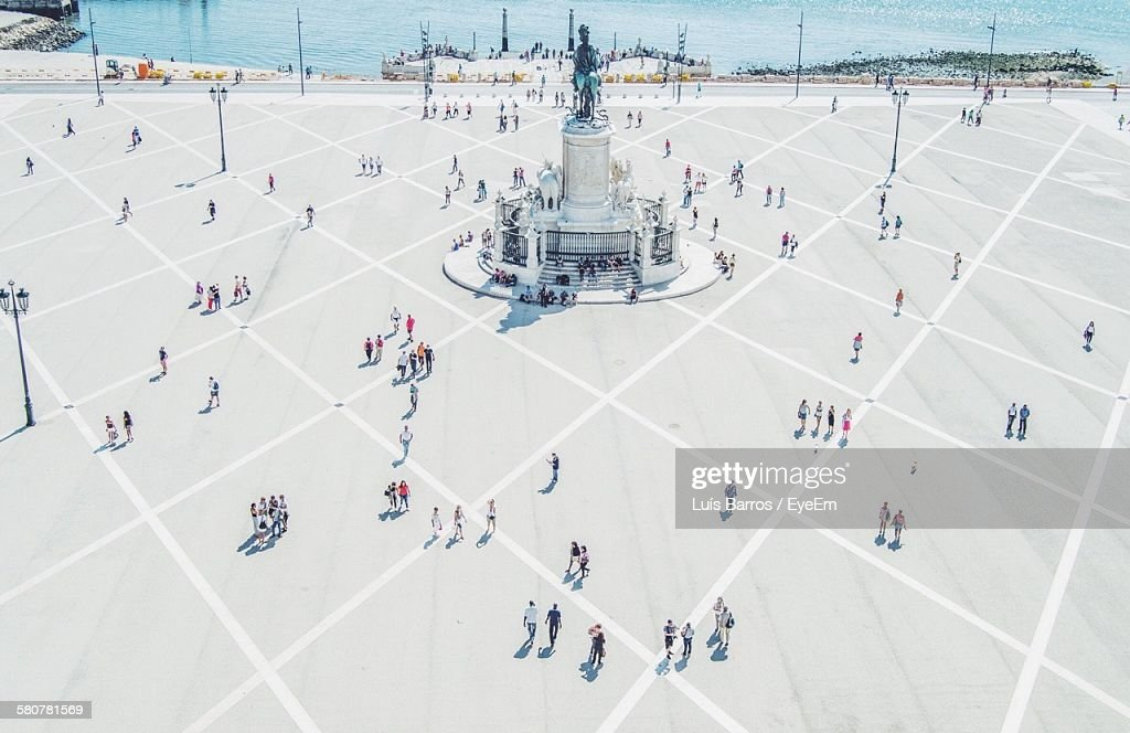 High Angle View Of People Near Statue At Praca Do Comercio : Stock Photo