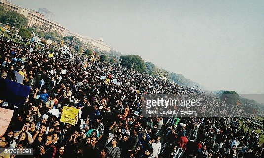 High Angle View Of People Protesting At Rally Against Sky