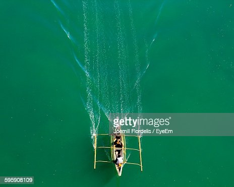 High Angle View Of People Traveling In Boat On River