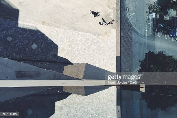 High Angle View Of People Walking By Modern Building