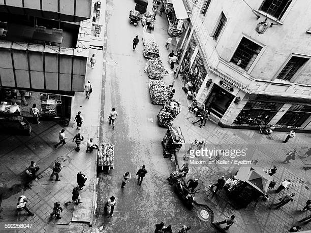 High Angle View Of People Walking On City Street