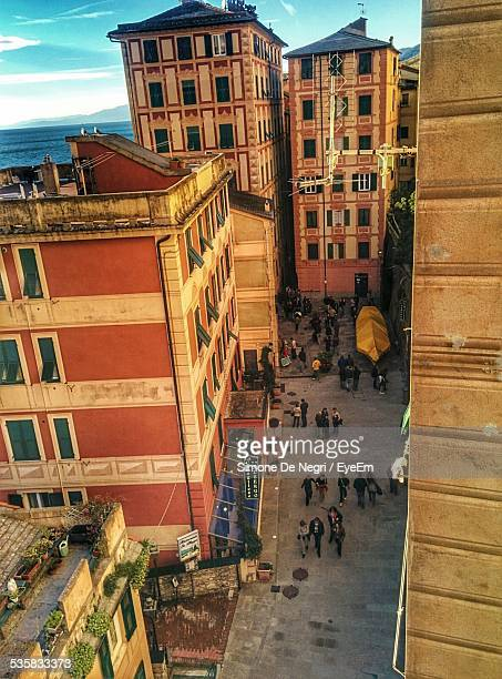 High Angle View Of People Walking On Street Amidst Buildings