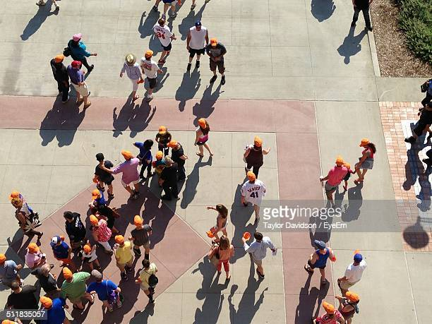 High angle view of people wearing orange caps